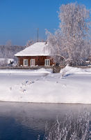 Altai russian country village Talitsa under winter snow on bank of river