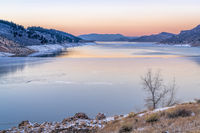 calm winter dusk over mountain lake