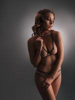 Image of elegant model posing in stylish lingerie