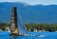 Sailing boat SUI 10 Ladycat powered by Spindrift Racing,Lake Geneva,peak La Dole behind, Switzerland