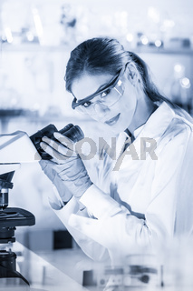 Female health care researchers working in scientific laboratory.