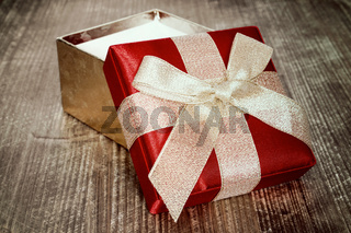 Open gift box with golden bow