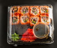 Sushi in the package on a black background
