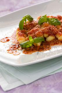 Gnocchi, Italian pasta with tomato sauce basil and grana cheese