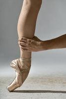 Guy holds ballerina's leg
