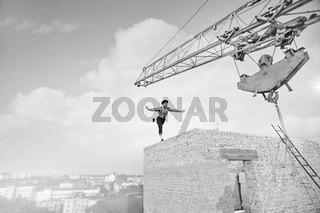 Vintage builder posing on top of a building under construction