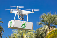 Unmanned Aircraft System (UAV) Quadcopter Drone Carrying Package With Food Symbol Label Over Tropical Terrain.