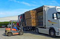 A forklift uploads pallets of graded cork on a truck, São Brás de Alportel, Algarve, Portugal