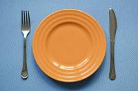 orange plate on blue