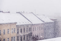 snow cityscape / rooftops during winter snowing