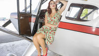 flight, Young traveling girl in antique floral dress in a vintage plane from the 50s, travel and enjoy the adventures