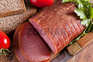 Rolled Fillet of Ham with Tomato and Bread as closeup