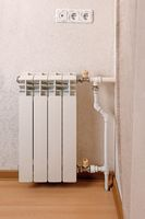 Modern hot water radiator on the wall