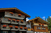Residential homes and vacation rentals with balconies in chalet style, Saas-Fee, Valais, Switzerland