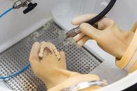 Dental Technician Cleans 3D Printed Dental Implant Bridge