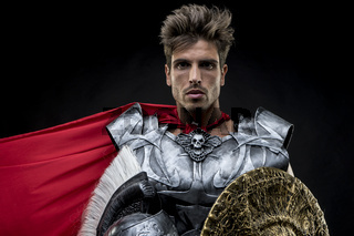 centurion or Roman warrior with iron armor, military helmet with horsehair and sword