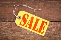 sale sign on a yellow price tag