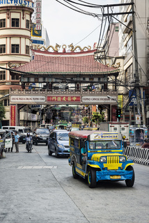 jeepney and busy street traffic in central manila chinatown philippines