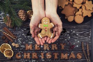 Woman hands keep ginger cookies