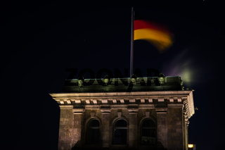 German Flag at Night on Reichstag Building in Berlin, Germany