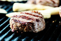 beef steak on grill with vegetables