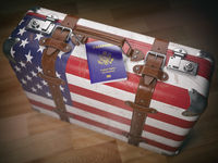 Travel or immigration concept. USA passport and suitcase with flag of USA.