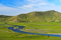 Tents in the river bed landscape of the Orkhon river, Orkhon Valley, Mongolia