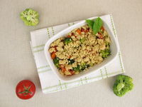 Vegetarian vegetable crumble with carrots, tomatoes, broccoli and crumbs