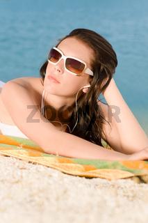Young sexy bikini model relaxing with sunglasses
