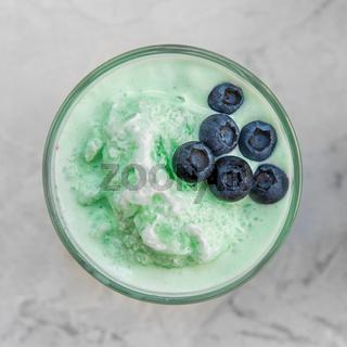 Blueberry smoothie on a white