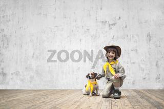 Boy in uniform with dog