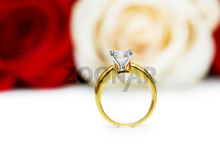 Wedding concept with roses and golden rings