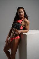 Photo of female bodybuilder posing in studio