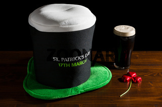 St Patrick day with a pint of black beer, hat and shamrock
