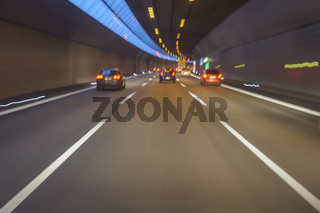 Cars Driving in Tunnel