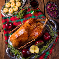 Roast Christmas duck with apples