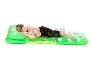Little boy on beach mattress