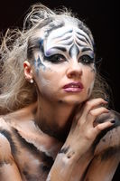 White tiger - beautiful model with bodypainting