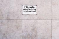 German sign Plakate ankleben verboten translates as post no bills