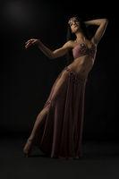 Dancer in Easten style costume full-length view