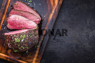 Barbecue wagyu point steak sliced as close-up on a cutting board with copy space