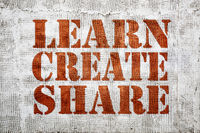learn, create, share graffiti on stucco wall
