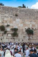 Jewish worshipers in white shawls