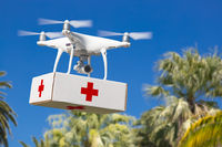 Unmanned Aircraft System (UAS) Quadcopter Drone Carrying First Aid Package Over Tropical Terrain.