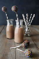 Bottles of chocolate milk with cake pops