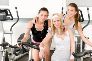 Fitness young girls spinning at gym posing