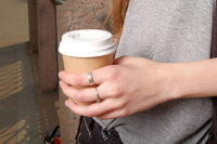 Takeaway coffee cup in young woman hand instagram effect