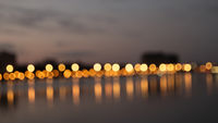 Bokeh night lights blurry abstract backgroun og city waterfront in a night