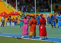 Female archers in traditional deel costumes, Naadam Festival, National Sports Stadium, Ulaanbaatar