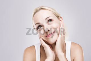 Cute dreaming woman with beautiful smile